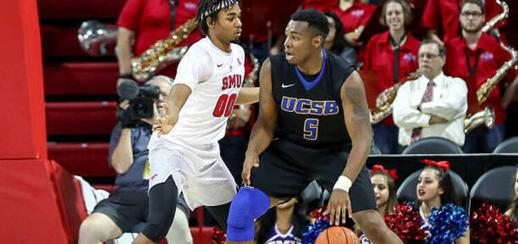 UNIVERSITY PARK, TX - NOVEMBER 22: UC Santa Barbara forward Jalen Canty (5) tries to get around SMU forward Ben Moore (00) durin